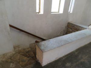 stairs in the chapel to go down to the grave cellar